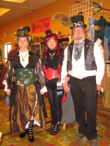 three people in steampunk cosplay