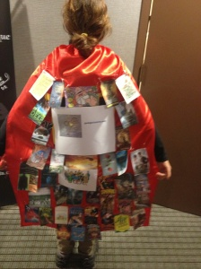 Dress up cape with book covers attached