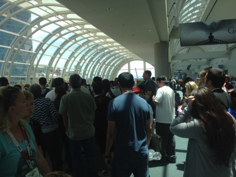 People trying to get on the escalator to the lobby and Exhibit Hall.