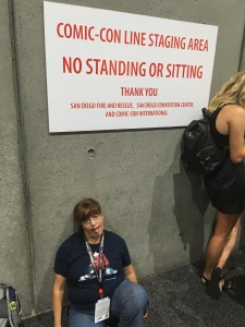 "me, looking fed up an exhausted, sitting under a ""no sitting"" sign"