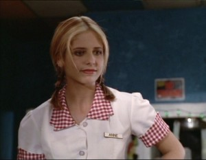 "Buffy in her waitress uniform from ""Anne"""